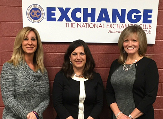Dr. Lisa Pescara-Kovach, left, posed for a photo with Louise Kachmarik, center, and Tracey Edwards, membership development manager and executive vice president with the National Exchange Club, respectively. Kachmarik and Edwards were on the committee that selected Pescara-Kovach to receive the Northwest Ohio 2015 Champion for Children Award.