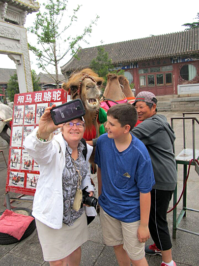 Peter Thomas won first place in the employee/staff category with this photo of Kathleen Walsh, UT director of web development, taking a selfie with Aaron Thomas, Peter's son, in Shanhaguan, China, that was taken while traveling as part of a UT delegation with the Confucius Institute.