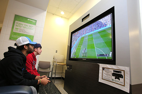 Students Justin Fowler, left, and Matthew Scarcipino played soccer on an Xbox system in the Student Union.