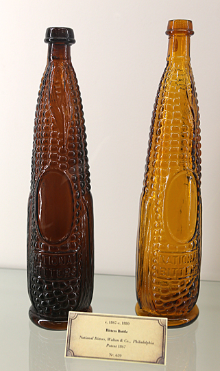 The exhibit includes these bitters bottles, which were produced circa 1867 to 1880 by Walton & Co. in Philadelphia.