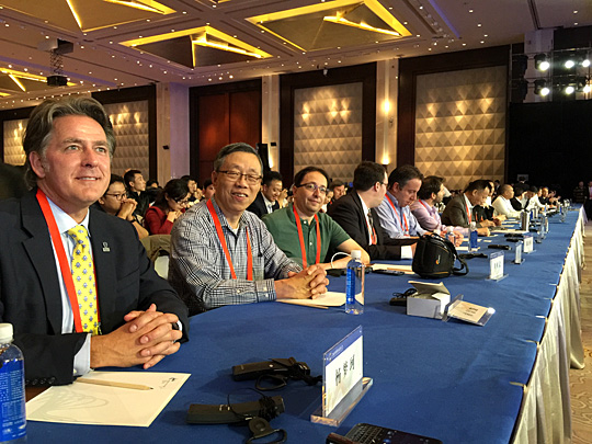 Scott McIntyre, left, recently attended and spoke at the 2015 World Crowdfunding Conference in Guiyang, China.