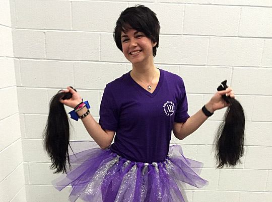 Katie Elco had 18 inches of her hair cut to raise funds; she donated $300 to Relay for Life and gave her locks to Pantene Beautiful Lengths, which creates wigs for women fighting cancer.