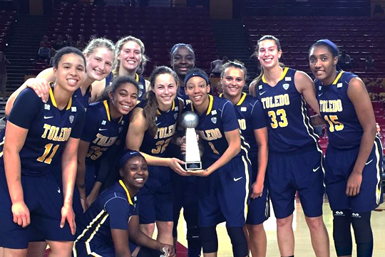 The Rockets posed with the Arizona State University Classic trophy after beating Virginia Commonwealth University, 80-61, in Wells Fargo Arena in Tempe.