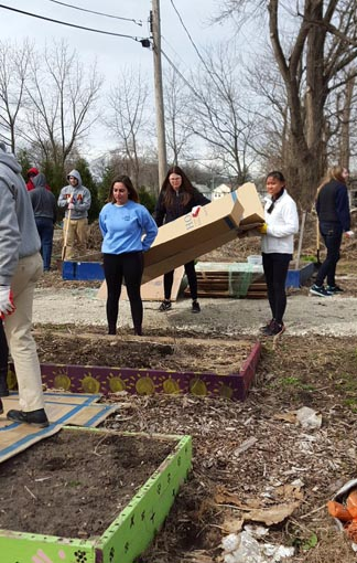 Alpha Xi Delta and Pi Kappa Alpha, a social sorority and fraternity, teamed up to clean up a local garden for this year's Big Event.