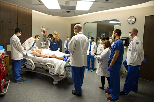 Third-year medical student Nathan Marcinkowski led the team in a state-of-the-art medical simulation suite, which served as the ER for the heroin overdose exercise.