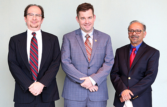 Receiving Outstanding Researcher Awards are, from left, Dr. Joseph Slater, Geoffrey Rapp and Dr. Sarit Bhaduri.