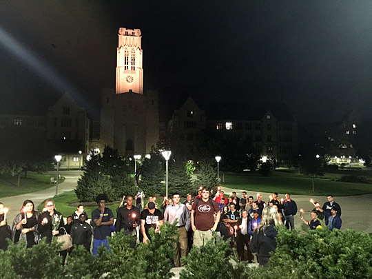 Students gathered Sept. 20 on Centennial Mall for a candlelight vigil to remember Don Reiber, associate professor of communication, who passed away suddenly that morning.