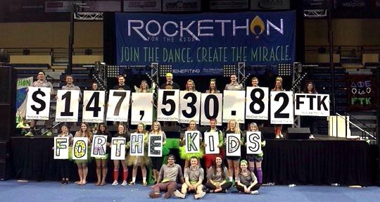 RockeTHON executive board members proudly held up the final fundraising number: $147,530.82 for Children's Miracle Network Hospital, Mercy Children's Hospital in Toledo.