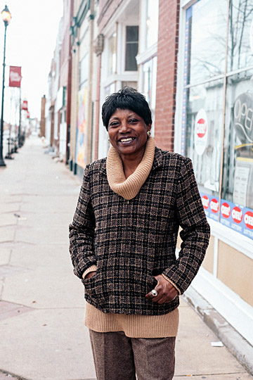 Christie, a local garden owner, was photographed in front of Tom's Carryout on Lagrange Street by Lucas Sigurdson.