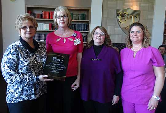 Patty MacAllister, support services coordinator, center left, presented the first Frances Clinton Service Award to Clinton's sisters, Paulette Smietana, left, and Mary Ann Nappens, and niece Paige.