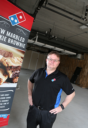 Brian Edler will open a Domino's Pizza at the Gateway this summer.