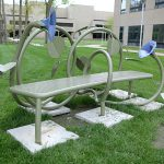 """Jim Gallucci's """"Listening Whisper Morning Glory Bench"""" beckons near the north entrance of UT Medical Center."""