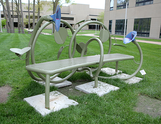 "Jim Gallucci's ""Listening Whisper Morning Glory Bench"" beckons near the north entrance of UT Medical Center."