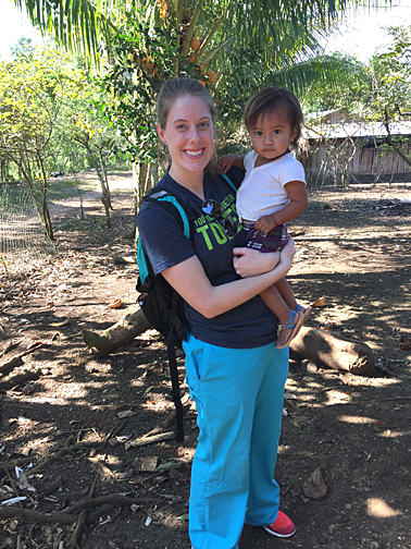 Jessica Schulte held a child she met during a weeklong trip to conduct research at an OB/GYN clinic in Petén, Guatemala.