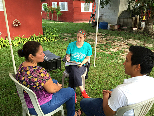 Jessica Schulte interviewed a patient, left, with the help of her translator in Petén, Guatemala. The master of public health student conducted research at an OB/GYN clinic during a recent trip.