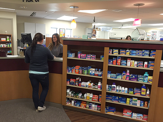 Hollie Younes, certified pharmacy technician, waited on a customer in the Main Campus Pharmacy.