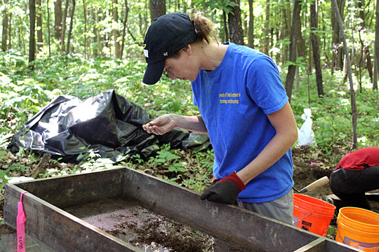 Dr. Melissa Baltus, archaeologist and UT assistant professor of anthropology, sifted through the soil from the excavation site at Wildwood Preserve Metropark.