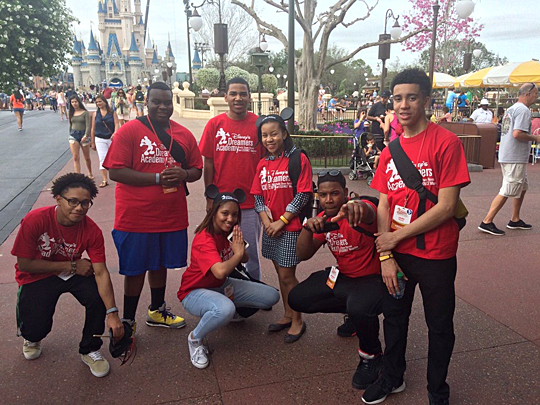 Andre Matthews, left, posed for a photo with other high school students who attended the Disney Dreamers Academy this spring. Matthews, an Upward Bound student, will graduate from Scott High School this week.