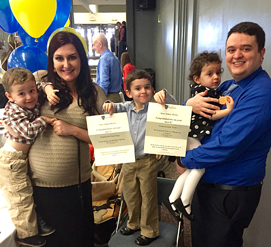 Anisa and Joshua Merris smiled for the camera at Match Day with their children, from left, Daniel, Jonathan and Grace. Their fourth child, Michael, was born less than a month after Match Day.