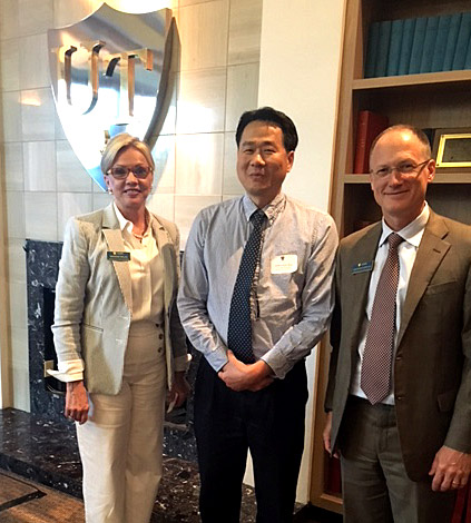 Dr. Joshua Park, center, posed for a photo with Marianne Ballas and Dr. Christopher Cooper, executive vice president for clinical affairs and dean of the College of Medicine and Life Sciences, after receiving a $50,000 grant through the UT Medical Research Society.