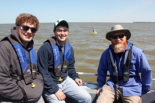 Zach Swan, a junior majoring in environmental studies, left, Ken Gibbons, research associate at the Lake Erie Center, center, and Dr. Thomas Bridgeman Toledo aboard the center's 28-foot research vessel.