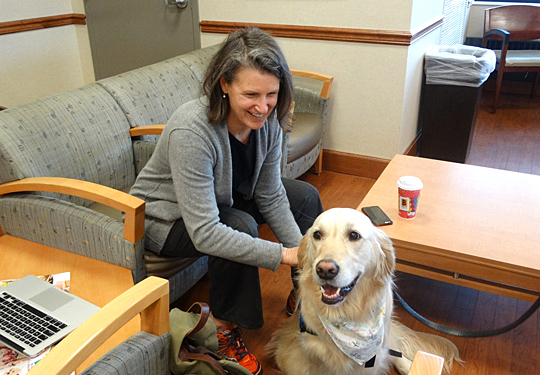 Susan Chilcote Bagley smiled during a visit with Anna, a comfort dog from Trinity Lutheran Church and School, while she waited for her father to get out of surgery at UT Medical Center.
