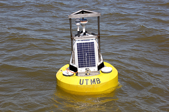The UT water quality and sensor buoy rides the waves off the shore of the Maumee Bay State Park Lodge in Oregon, Ohio.