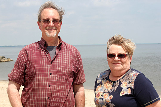 Dr. Daryl Dwyer, UT ecology professor, and Pam Struffolino, research operations manager at UT Lake Erie Center, are on the public beach at Maumee Bay State Park to oversee the daily water testing.