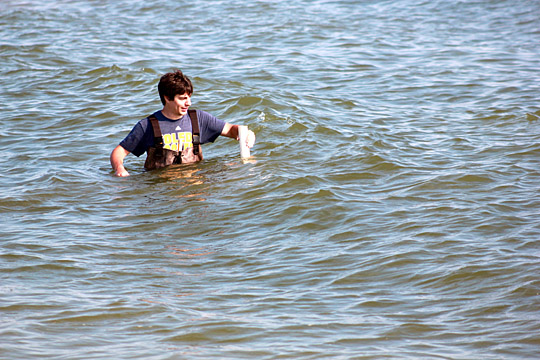 UT senior Kevin Corbin held a wave stick at Maumee Bay State Park to collect data that helps forecast water quality for Lake Erie swimmers.