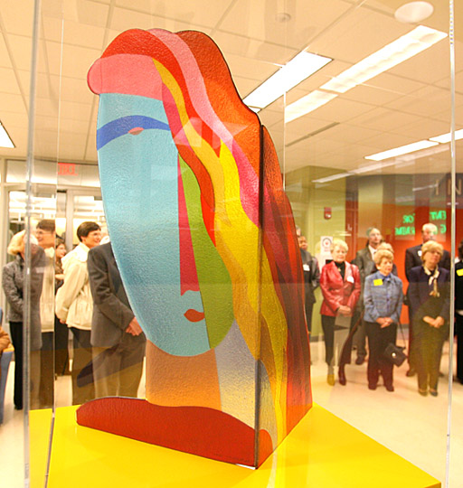 """""""A University Woman,"""" a glass sculpture by local artist Tom McGlauchlin, serves as the logo for Women & Philanthropy at The University of Toledo. The piece is located in the Carlson Library concourse and was made possible by the group's first grant in 2008."""