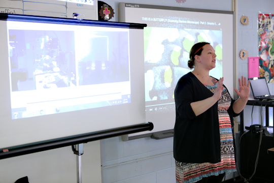 Cassandra Pittman, UT student and SCOPE project manager, explained to students at Summit Academy how they could use the University's scanning electron microscope from their school.