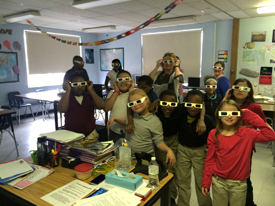 Students at Summit Academy wore 3-D glasses to view images created using UT's scanning electron microscope. Dr. Kristin Kirschbaum, director of the UT Instrumentation Center and creator of SCOPE, is in the center in the back row.