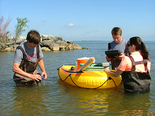 Kevin Corbin, UT senior, left, Ryan Jackwood, UT PhD student, and Jessica Reker, a senior at Xavier University, collected water samples at Maumee Bay State Park.