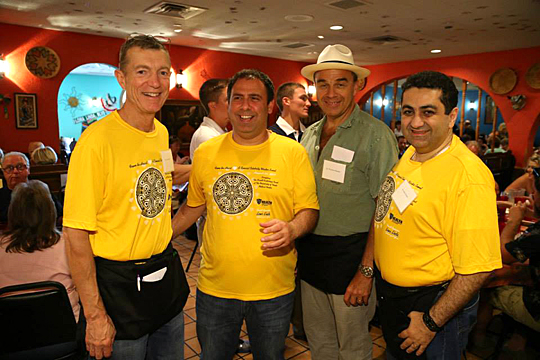 Servers at last year's Celebrity Wait Night included, from left, Dr. Mark Burket, Dr. George Moukarbel, Dr. Thomas Schwann and Dr. Samer Khouri.