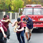 Students competed in the fire truck pull during Pi Kappa Alpha Fireman's Challenge last year.