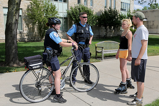 UT Police Officers Desiree Beatty and Pat Greene talked with two students on Main Campus.