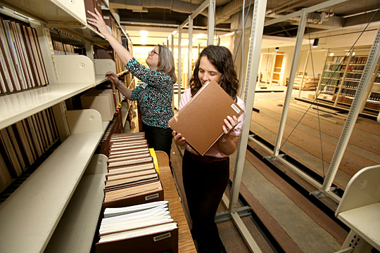 Lucy Duhon, coordinator of library sharing and associate professor, left, and Margaret Hoogland, clinical medical librarian and assistant professor, helped move more than 100,000 volumes on the third floor during renovations in Carlson Library.