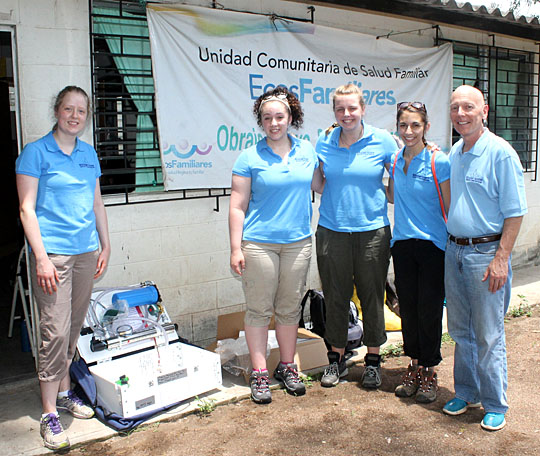 The UT team, from left, Kayla Piezer, Lisa Young, Alison Haas, Kylee Kramer and Dr. Glenn Lipscomb, posed for a photo with the water purification unit that the students constructed in Toledo before taking it to El Salvadore.