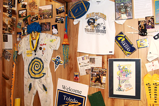Donovan Nichols' Blue Crew uniform is among the memorabilia featured in the Rocket Room. He and friend Jason Rodriguez started the masked spirited squad when they were undergraduates in 2000.