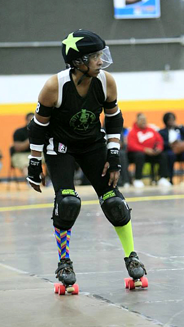GunSmoke, a.k.a. Ulonda Sweeney, is ready to roll as a jammer for the Glass City Rollers in a bout against Circle City Party Crashers last spring.