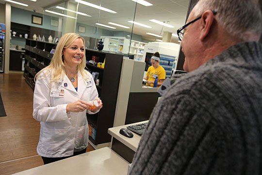 Holly Smith, UTMC Outpatient Pharmacy manager, talked with a customer.