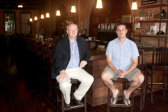 Dr. Neil Reid and Andy Moore, Mike Moore's brother, got together recently at the Black Cloister Brewing Co. in Toledo.