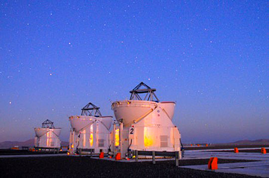 This shows three 1.8-meter telescopes of the Very Large Telescope Interferometer of the European Southern Observatory in Chile.