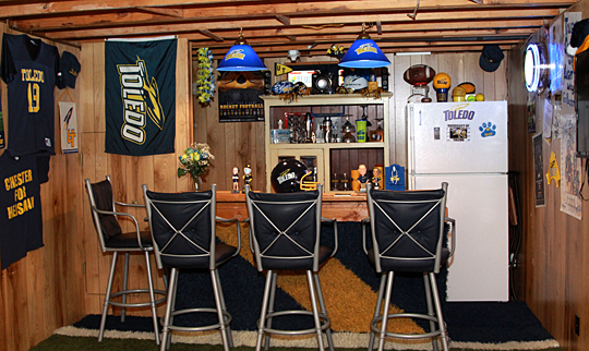 The bar in Donovan Nichols' Rocket Room features turf from the blue rocket that was in the center of the field in the Glass Bowl.