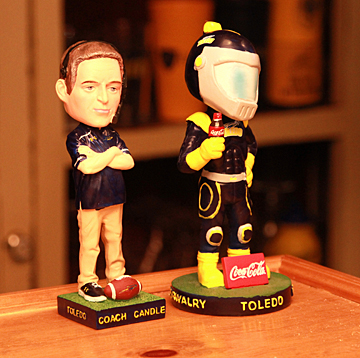 Bobbleheads of Football Coach Jason Candle and Rocky sit atop the bar.