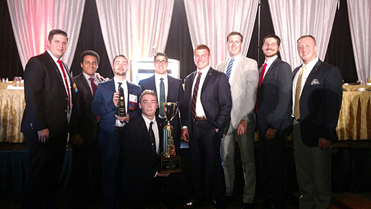Members of the UT Epsilon Epsilon chapter of Pi Kappa Alpha received the Smythe Award for the third year in a row. The honor is given to the top 10 percent of chapters. Posing for a photo were, from left, Mitchell Wiese, Isaiah Ingram, Michael Peachock, Ross Kammerer (kneeling), UT alumnus Jeff Farris, Blake Miller, UT alumnus Michael Hericks, Jarrett Brayer and UT alumnus Jared Mayo.
