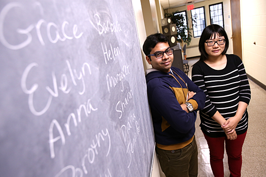 Ram Mukherjee, left, analyzed the popularity of names for newborn girls, a project supervised by Dr. Tian Chen, assistant professor.
