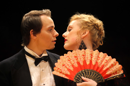 "Baron Popoff's wife, Natalie (Meridian Prall), enjoys a dangerous flirtation with the Vicomte Camille de Jolidon (William Floss) in a scene from UT's production of ""The Merry Widow."""