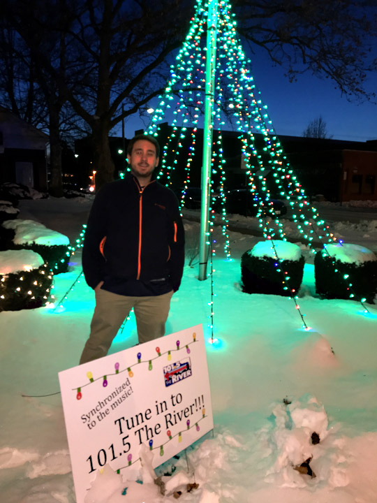 Alec Connolly, a UT junior majoring in electrical engineering who is working a co-op at iHeartMedia, posed for a photo by the lights that he synced for 101.5's Christmas on the River.
