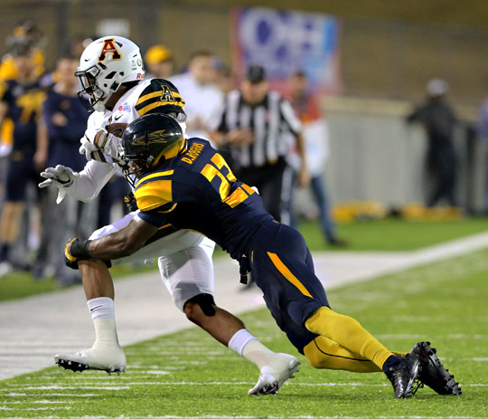 Senior DeJuan Rogers took down a Mountaineer.